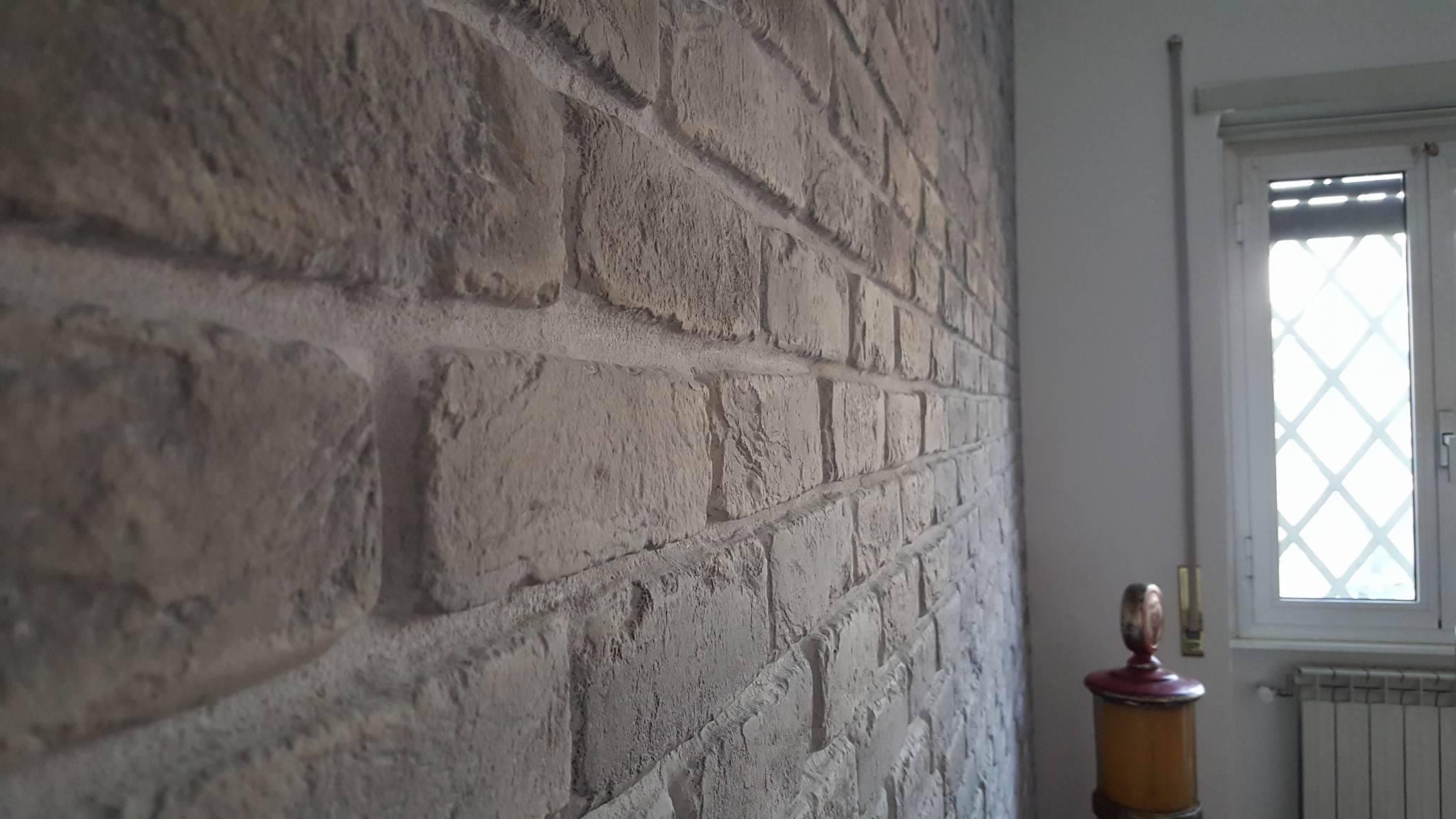 Mattoni pareti interne pareti bianche con mattoni a vista for Muri colorati moderni